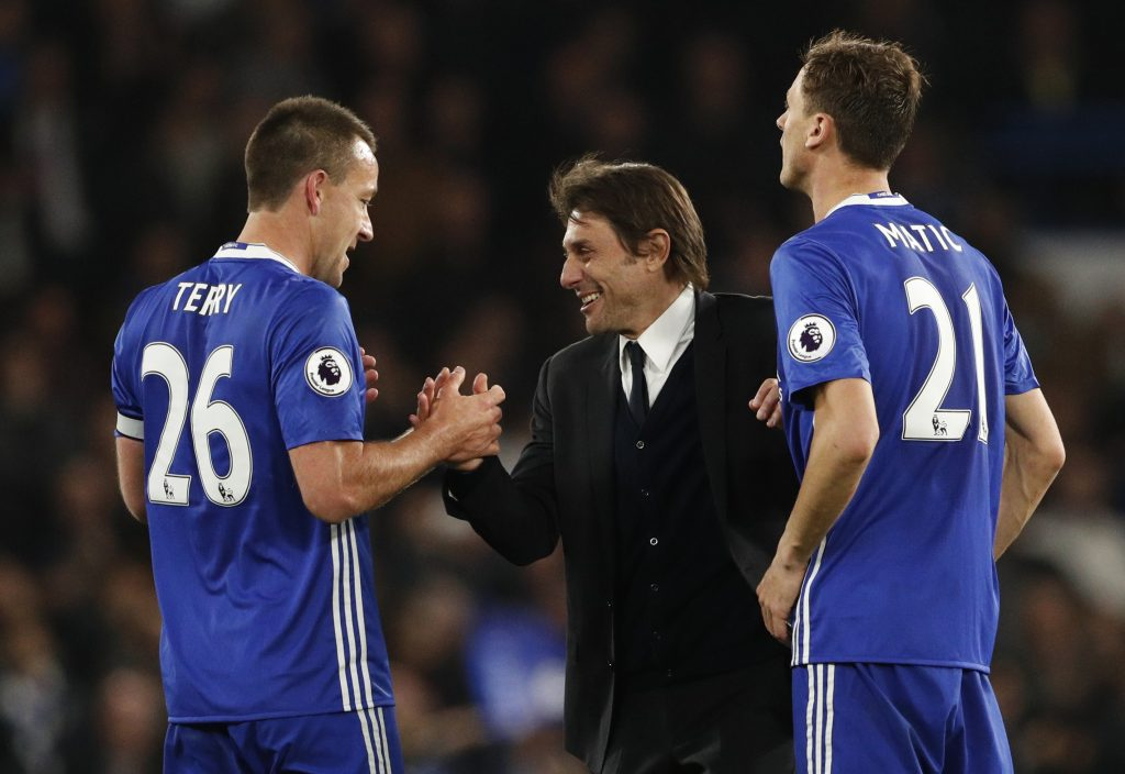 Chelsea manager Antonio Conte celebrates after the match with John Terry and Nemanja Matic.
