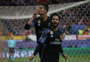 Real Madrid's Isco celebrates scoring their first goal with Cristiano Ronaldo.