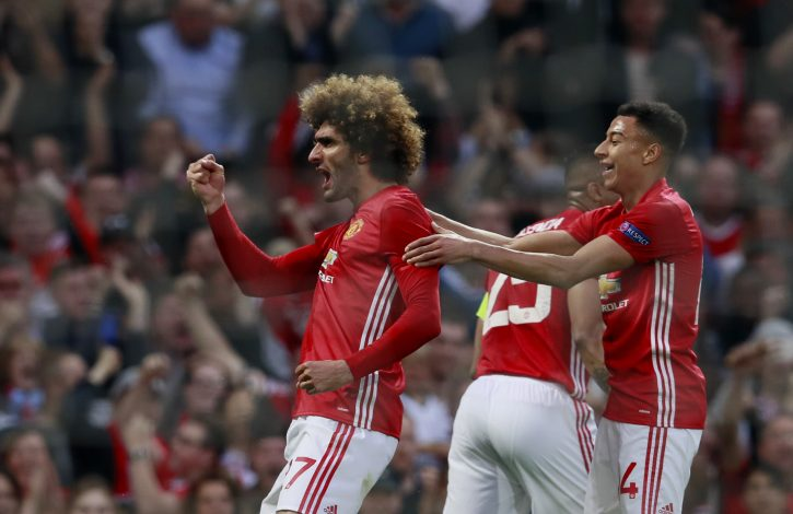 Marouane Fellaini celebrates scoring their first goal with Jesse Lingard.