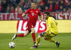 Bayern Munich's Robert Lewandowski in action with Benfica's goalkeeper Ederson.