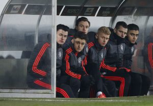 Manchester United's William Keane, Regan Poole, Joe Riley and James Weir on the bench.