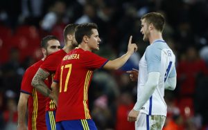 Spain's Ander Herrera clashes with England's Eric Dier after the match.