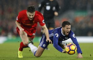 Eden Hazard in action with Liverpool's Adam Lallana.