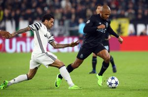 Juventus' Dani Alves in action with FC Porto's Yacine Brahimi.