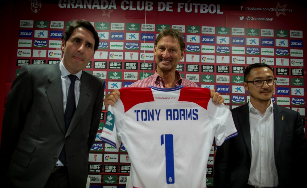 Former Arsenal and England captain Tony Adams (C) holds Granada's jersey.