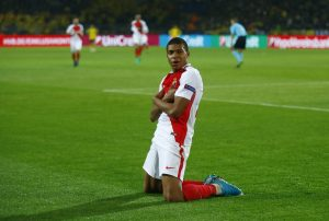 Monaco's Kylian Mbappe-Lottin celebrates scoring their third goal.