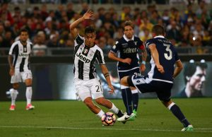 Juventus' Paulo Dybala in action with Lazio's Stefan de Vrij.