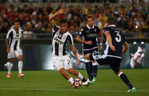 Juventus' Paulo Dybala in action with Lazio's Stefan de Vrij.