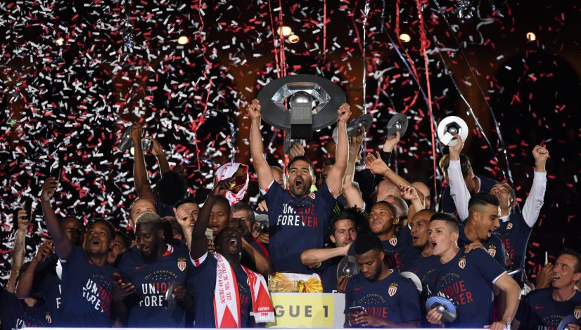 Monaco's Radamel Falcao celebrates with the trophy and team mates after winning Ligue 1.