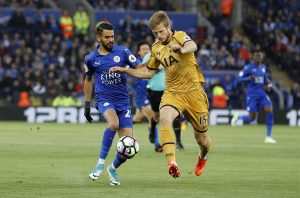 Tottenham's Eric Dier in action with Leicester City's Riyad Mahrez.