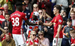 Manchester United's Josh Harrop celebrates scoring their first goal with Axel Tuanzebe.