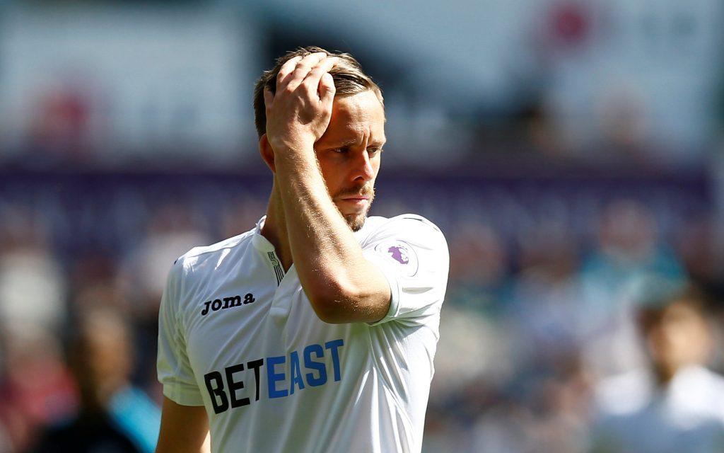Swansea City's Gylfi Sigurdsson looks dejected.