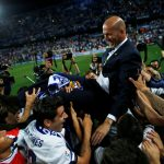 Real Madrid coach Zinedine Zidane is carried by his players as they celebrate winning La Liga.