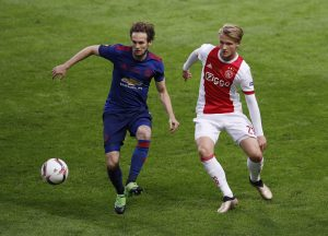 Manchester United's Daley Blind in action with Ajax's Kasper Dolberg.