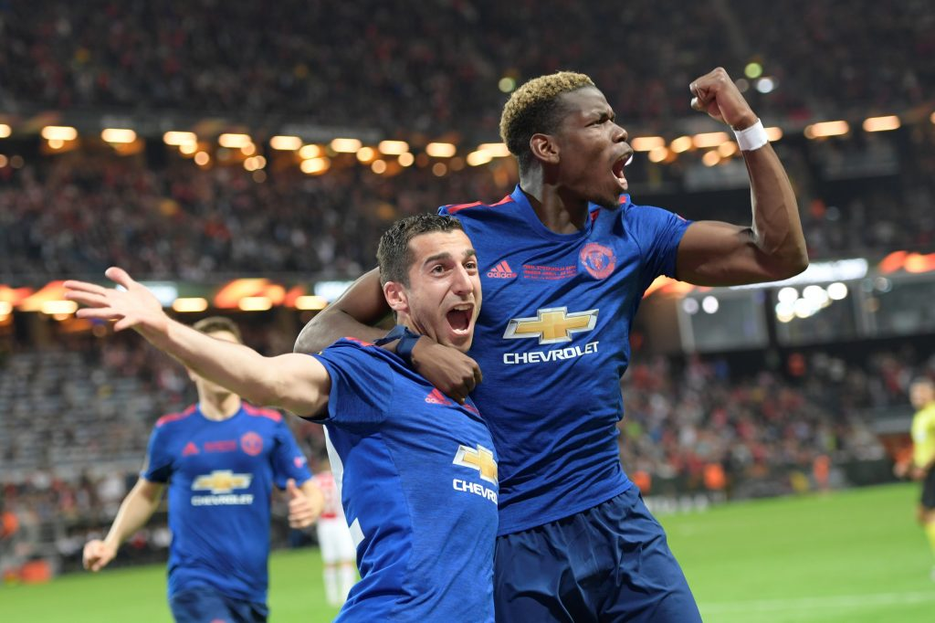 Henrikh Mkhitaryan (L) of Manchester United celebrates a goal with teammate Paul Pogba.