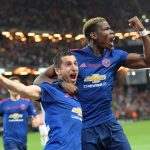 Henrikh Mkhitaryan (L) of Manchester United celebrates a goal with teammate Paul Pogba.