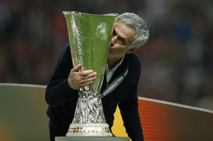 Manchester United manager Jose Mourinho celebrates winning the Europa League with the trophy.