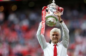 Arsenal manager Arsene Wenger celebrates with the trophy after winning the FA Cup final.