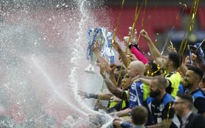 Huddersfield Town celebrate with the trophy after winning the Sky Bet Championship Play-Off Final and getting promoted to the Premier League.