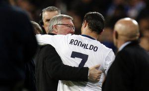 Sir Alex Ferguson (L) speaks to Cristiano Ronaldo.