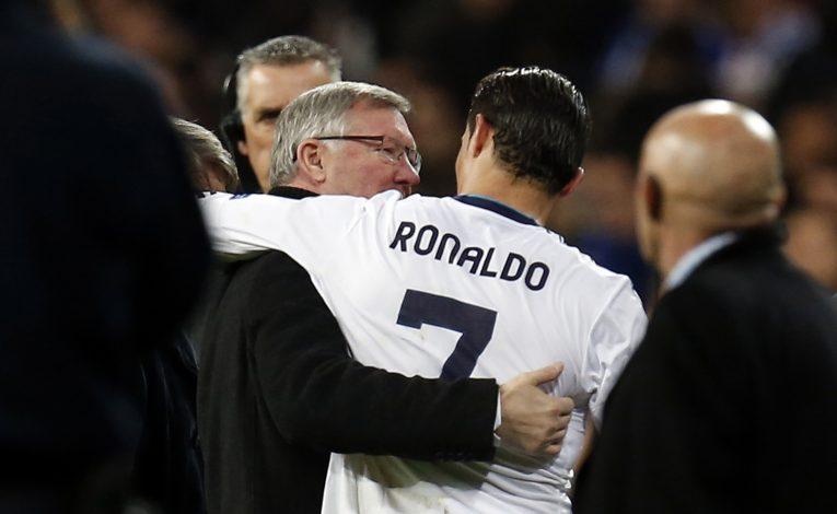 Sir Alex Ferguson (L) speaks to Cristiano Ronaldo.