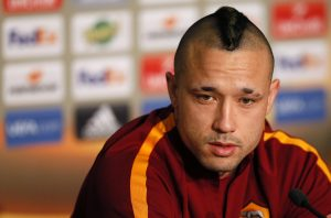 AS Roma's player Radja Nainggolan attends a news conference.