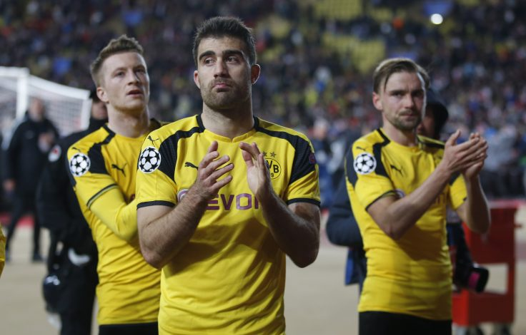 Borussia Dortmund's Sokratis Papastathopoulos applauds fans after the match.