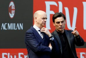 AC Milan's CEO Marco Fassone and coach Vincenzo Montella talk before the match.