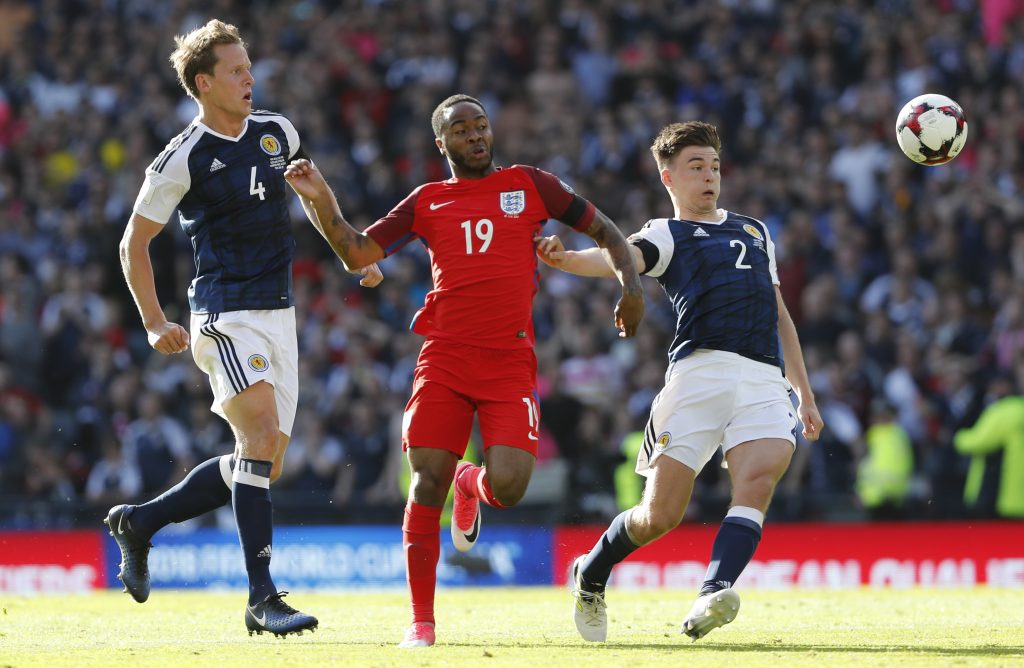 England's Raheem Sterling in action with Scotland's Kieran Tierney and Christophe Berra.