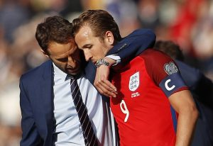 England manager Gareth Southgate speaks with Harry Kane after the game.