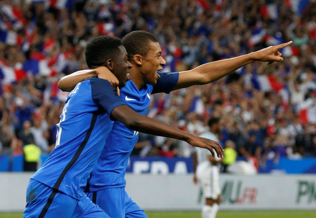 France's Ousmane Dembele celebrates scoring their third goal with Kylian Mbappe.