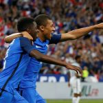 France's Ousmane Dembele celebrates scoring their third goal with Kylian Mbappe.
