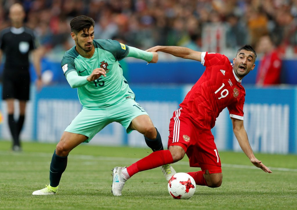 Portugal's Andre Gomes in action with Russia's Aleksandr Samedov.