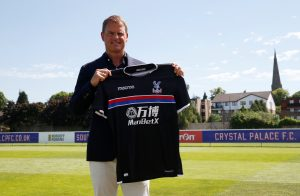 New Crystal Palace manager Frank de Boer poses with the club shirt.