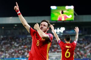 Spain's Saul Niguez celebrates after scoring a goal.