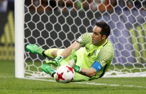 Chile's Claudio Bravo saves from Portugal's Nani to win the penalty shootout.
