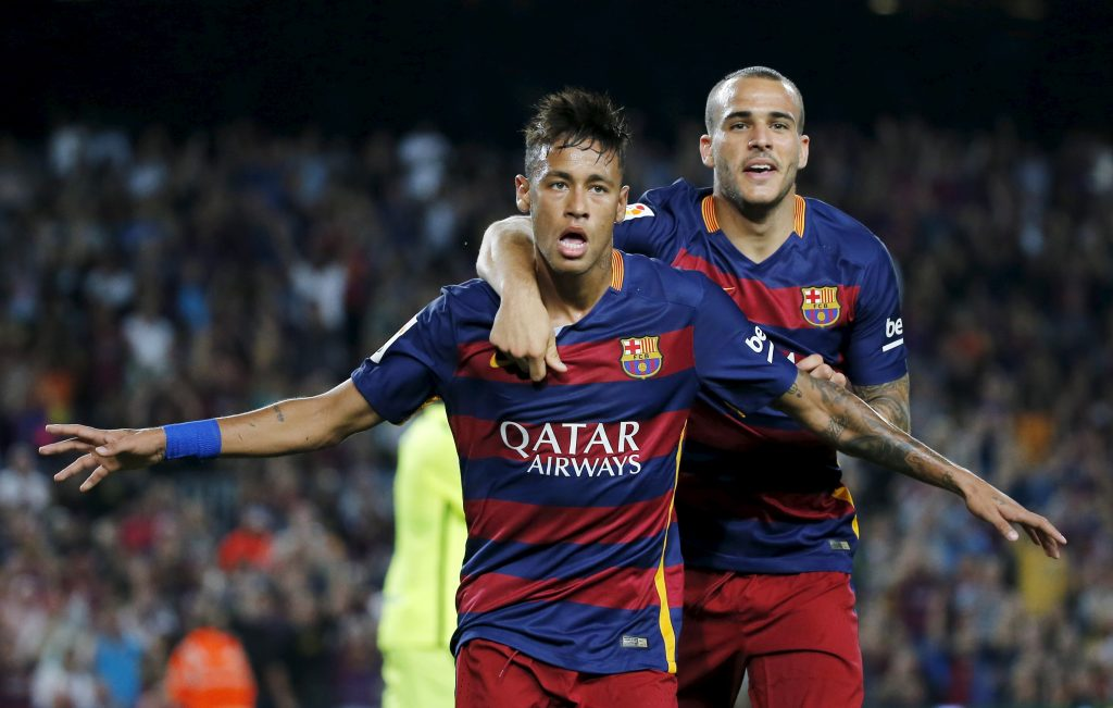 Barcelona's Neymar (L) and Sandro Ramirez celebrate goal.