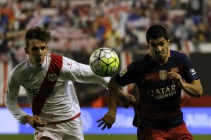 Barcelona's Luis Suarez (R) and Rayo Vallecano's Diego Llorente in action.