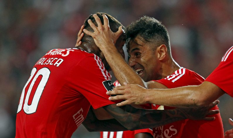 """Benfica's Jonas Goncalves (R) celebrates his goal against Belenenses with teammate Anderson """"Talisca""""."""