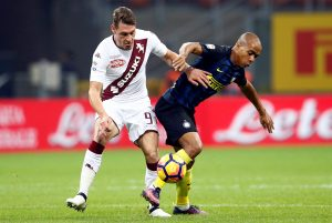 Inter Milan's Joao Mario (R) in action against Andrea Belotti of Torino.