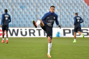 France's Corentin Tolisso attends a training session.