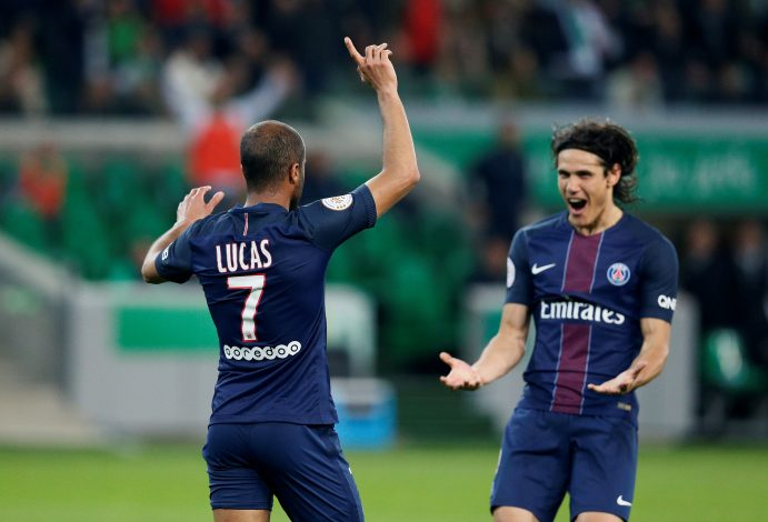 Paris Saint-Germain's Lucas Moura celebrates scoring their second goal with Edinson Cavani.