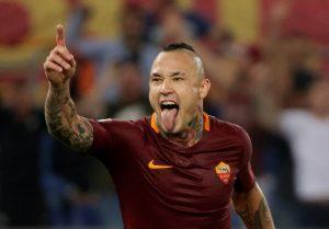 Roma's Radja Nainggolan celebrates scoring their third goal.