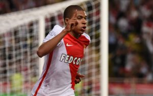 Monaco's Kylian Mbappe celebrates scoring their first goal.