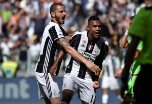 Juventus' Alex Sandro celebrates scoring their third goal with Leonardo Bonucci.
