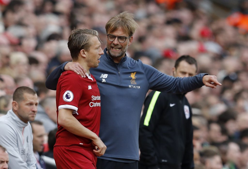 Liverpool manager Jurgen Klopp speaks to Lucas Leiva as he prepares to come on as a substitute.