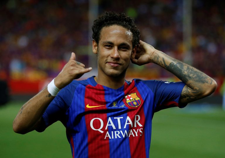 Barcelona's Neymar celebrates at the end of the match.