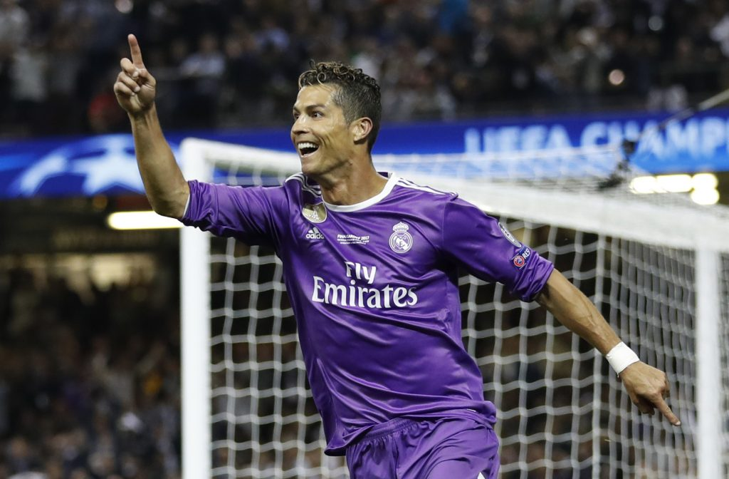 Real Madrid's Cristiano Ronaldo celebrates scoring their third goal.