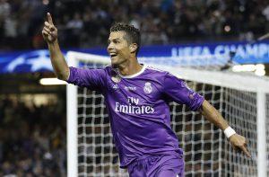Real Madrid's Cristiano Ronaldo celebrates scoring their third goal.