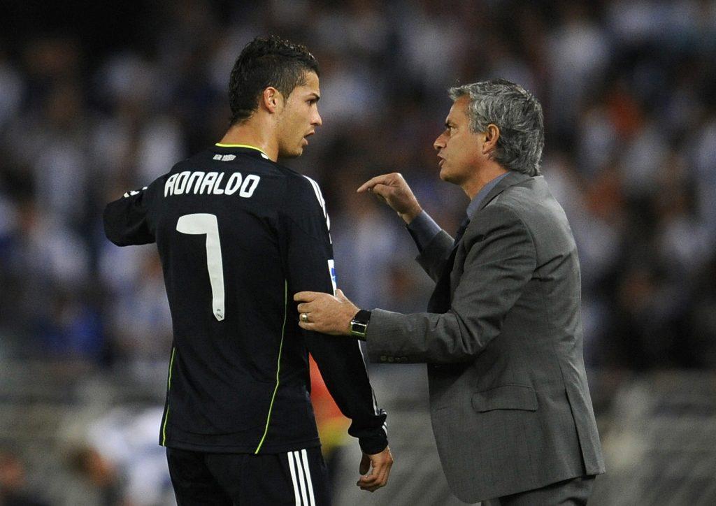 Jose Mourinho gives instructions to Cristiano Ronaldo.